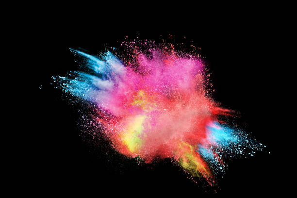 freeze motion of colored powder explosions isolated on black background - abstract multicolored powder explosion stock photos and pictures
