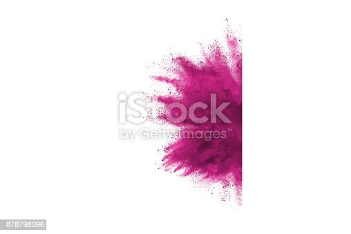 istock Freeze motion of colored powder explosions isolated on white background 878798096