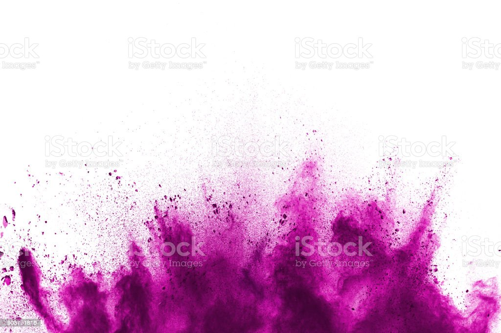Freeze motion of colorful  painted powder exploding  on  background. Abstract design of purple color dust cloud. Purple Particles explosion. Splash of colorful painted powder on white background. stock photo