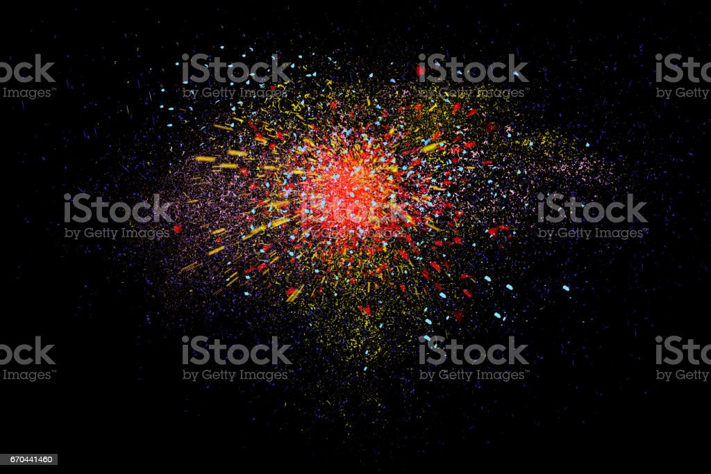 Freeze motion of colorful powder exploding isolated on black, stock photo