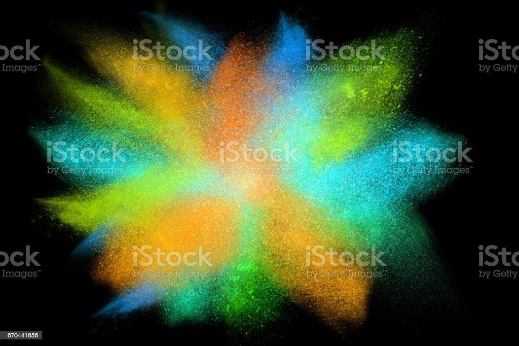 Freeze motion of colorful powder exploding isolated on black, stock photo