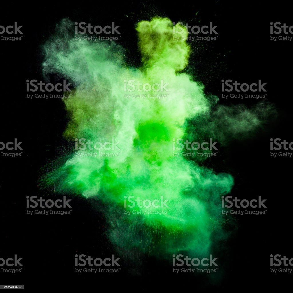 Freeze motion of green dust explosion stock photo