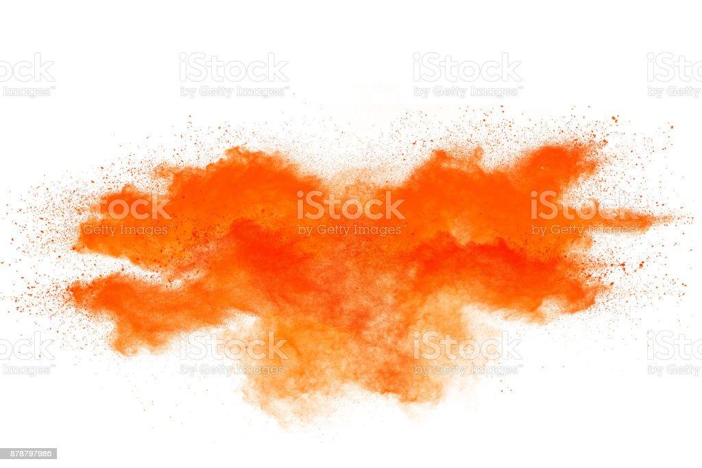 Freeze motion of orange powder explosions isolated on white background stock photo