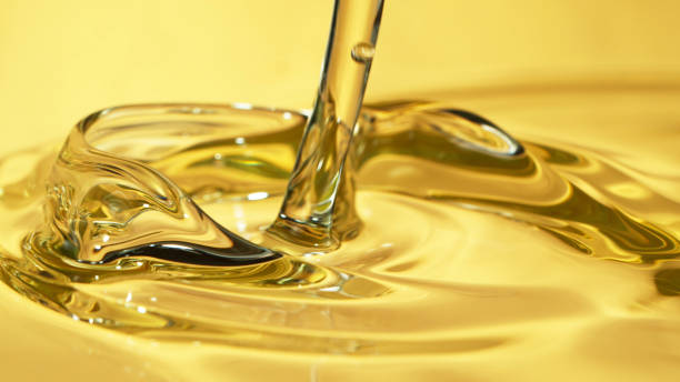 Freeze motion of pouring oil stock photo