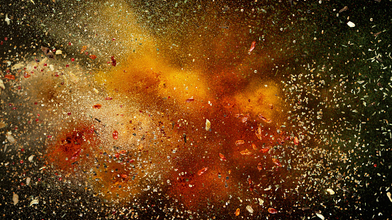 Freeze motion of various spice explosion, abstract culinary background