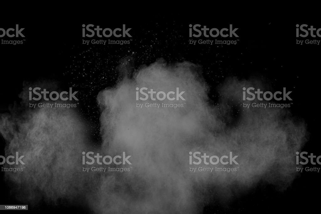 Freeze motion of white particles on black background. Powder...