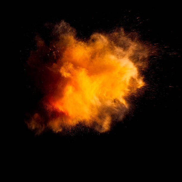 freeze motion of yellow dust explosion - abstract multicolored powder explosion stock photos and pictures