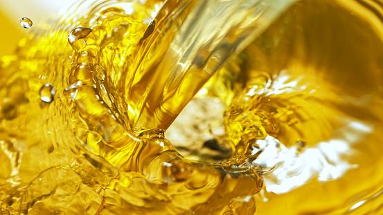 Freeze Motion Shot of Splashing White Wine on Golden Background