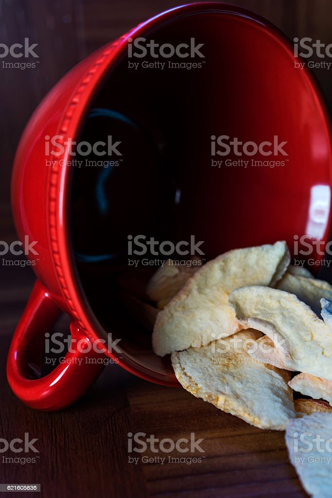 freeze-dried apple slices in red cup royalty-free stock photo