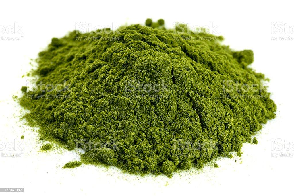 freeze-dried organic wheat grass powder stock photo