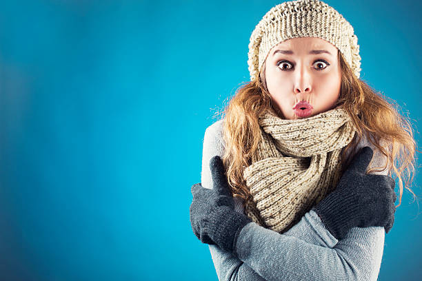 Freezing Young woman with scarf beret and glove shivering warm clothing stock pictures, royalty-free photos & images