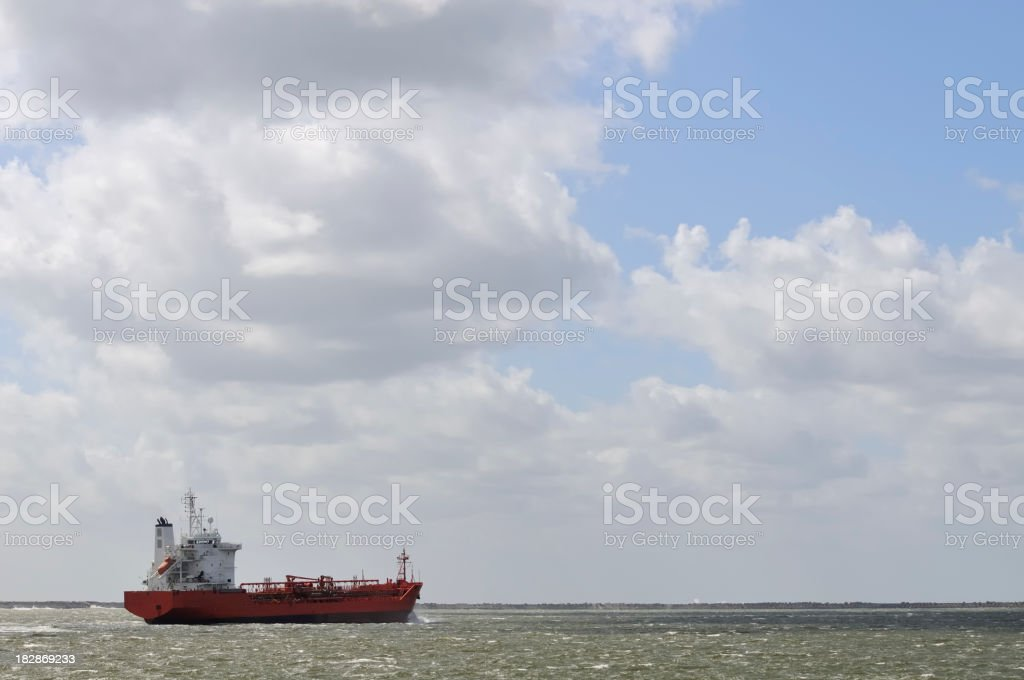 Freight ship leaving the harbor royalty-free stock photo