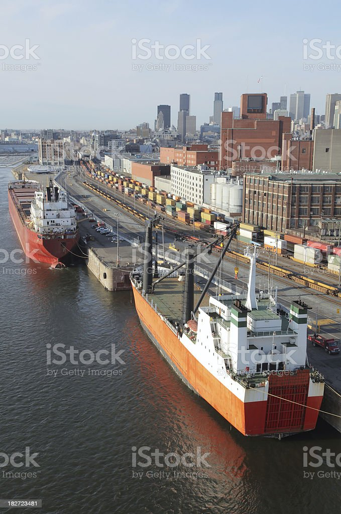 Freight ships and trains in the Montreal city harbor royalty-free stock photo