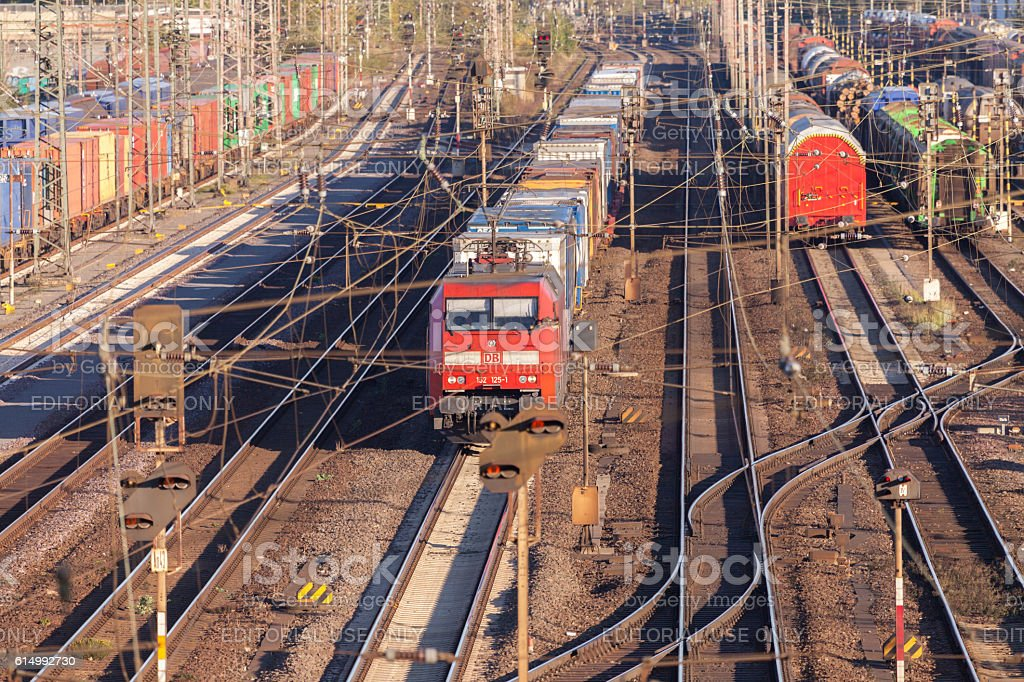 freight train from german rail drives through the freight yard stock photo