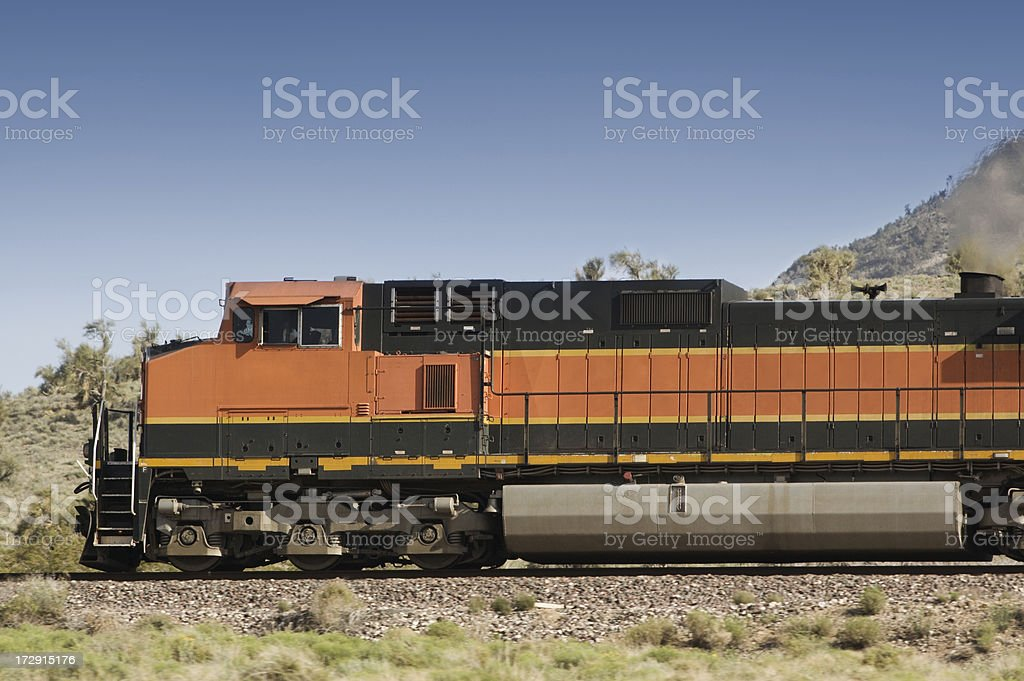 A freight train going past a mountain stock photo