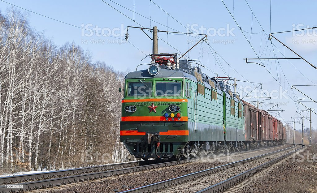 Freight train hauled by electric locomotive royalty-free stock photo