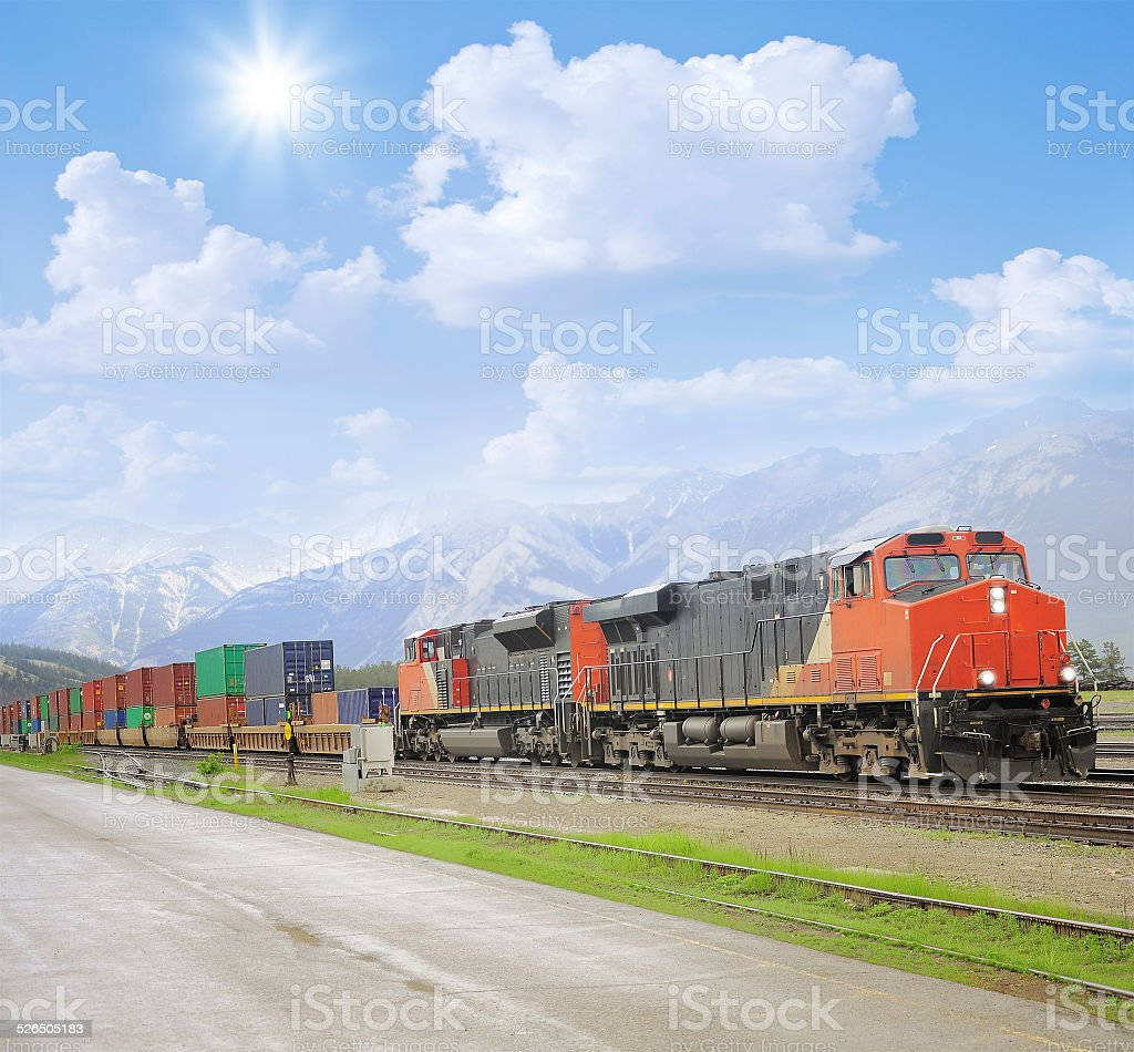 Freight train in Canadian rockies. stock photo