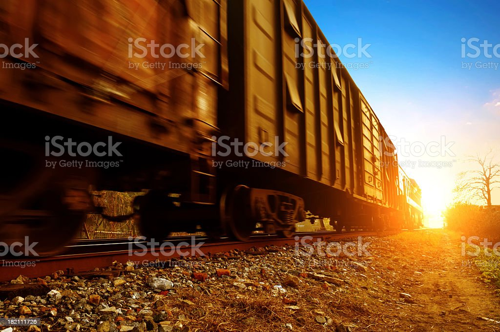 A freight train in motion on a sunny day stock photo