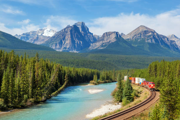 Freight train in the mountains stock photo