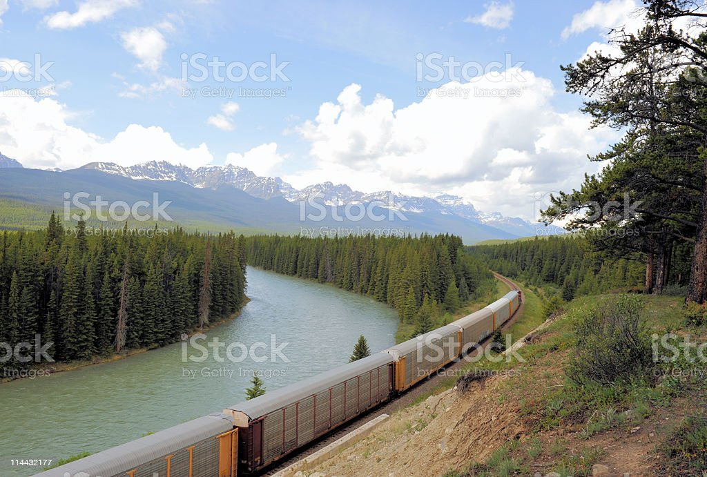 Freight train in the Rocky Mountains royalty-free stock photo