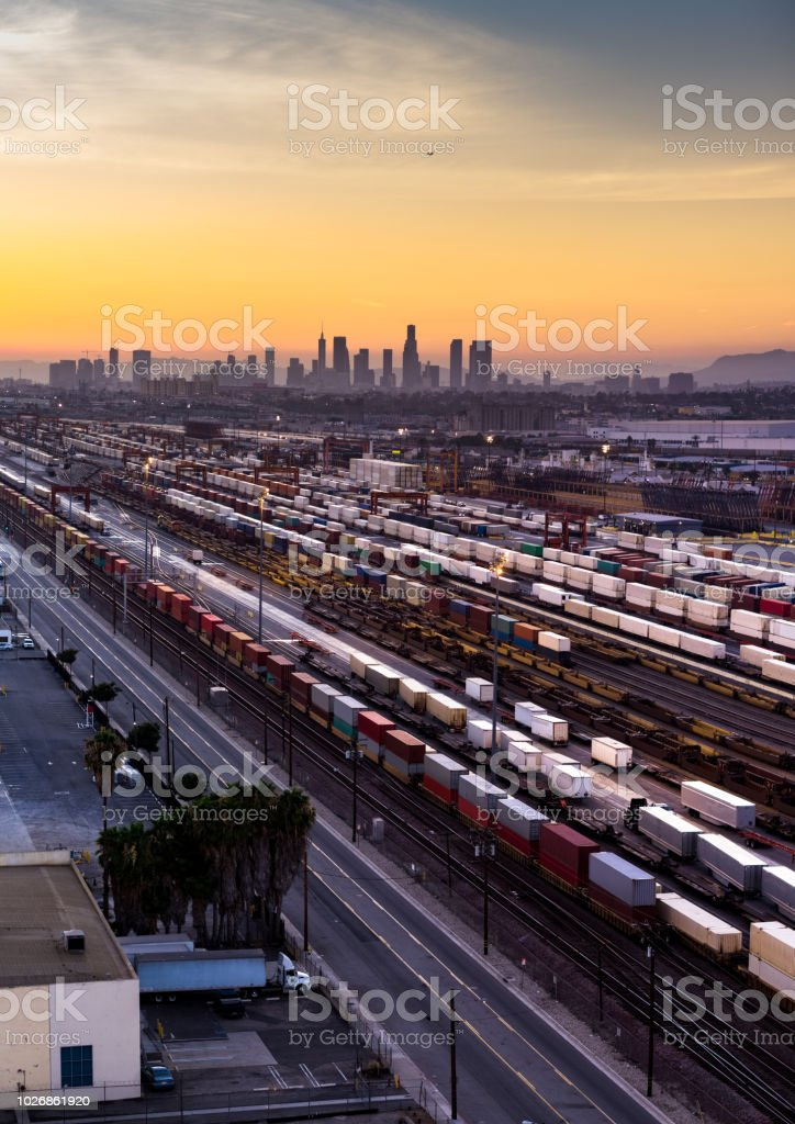 Freight Train Loading in Vernon with Los Angeles Skyline at Sunset stock photo