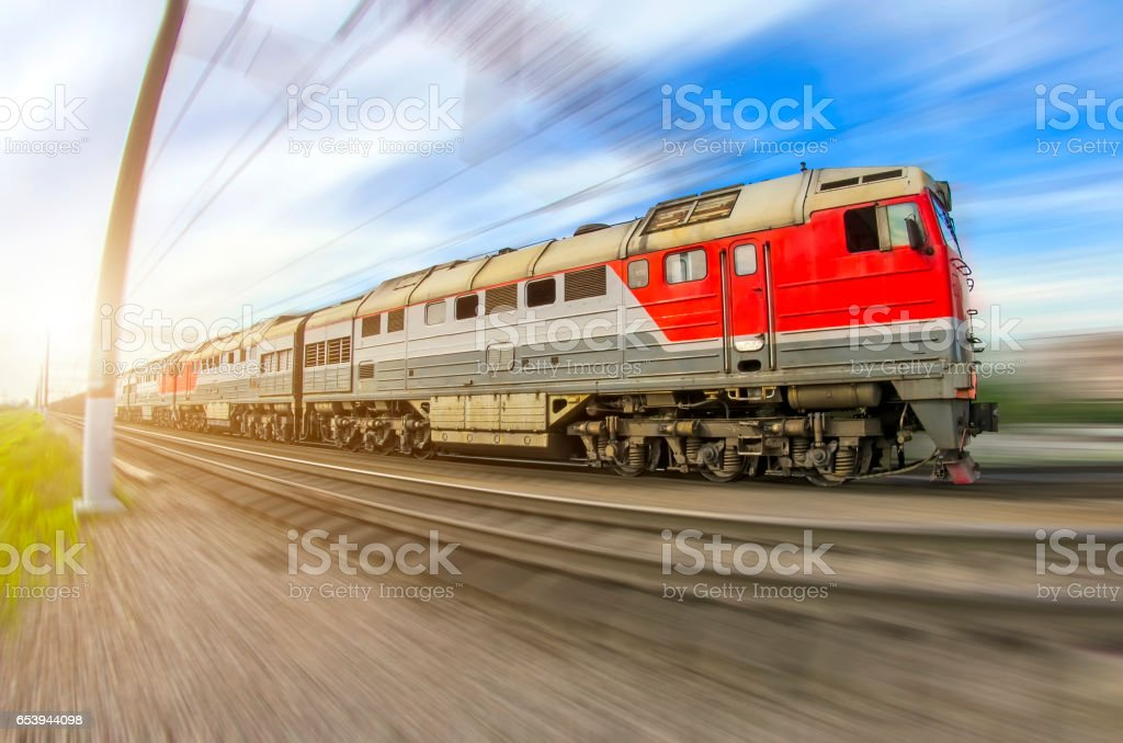 Freight train long locomotive rides speed railway stock photo