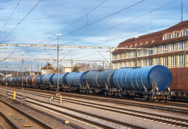 Freight train on railway tracks.  Cargo train in Germany Train cargo wagons on railway tracks in Singen train station, Germany, at sunset. Blue freight train and railroad. Merchandise transport. singen stock pictures, royalty-free photos & images