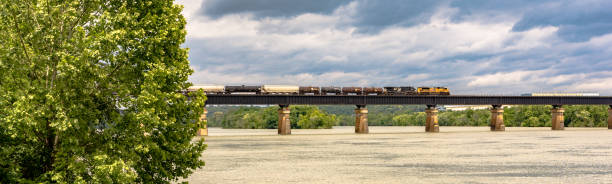 freight train over the tennessee river - loudon stock photos and pictures