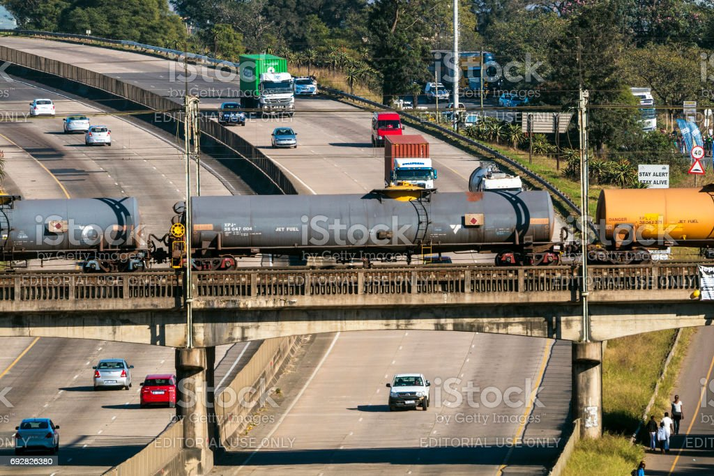 Freight Train Passing Over Busy N3  Highway stock photo