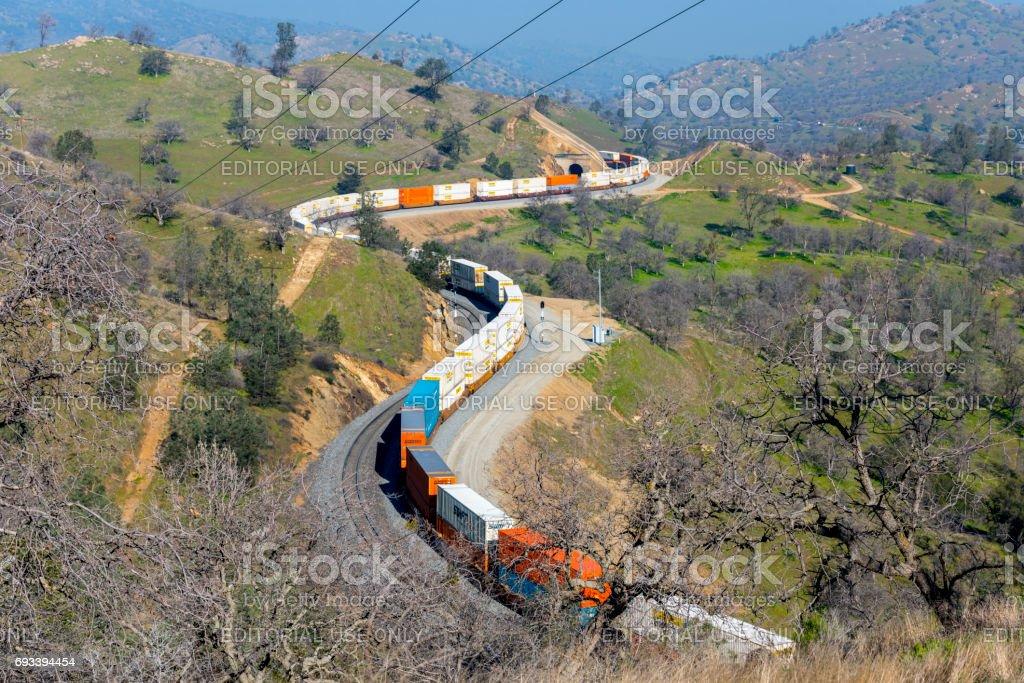 Freight Train passing over Tehachapi Loop  Kern County  California  USA stock photo