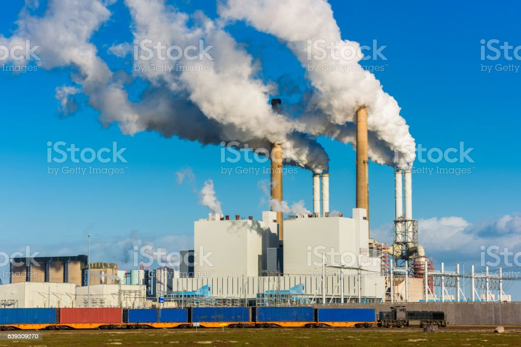 Freight Train passing Power Plant in Harbour of Rotterdam stock photo