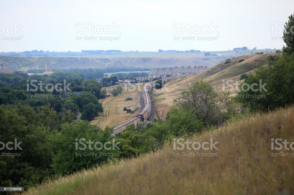 Freight Train Snaking Through Medicine Hat Alberta Valley stock photo