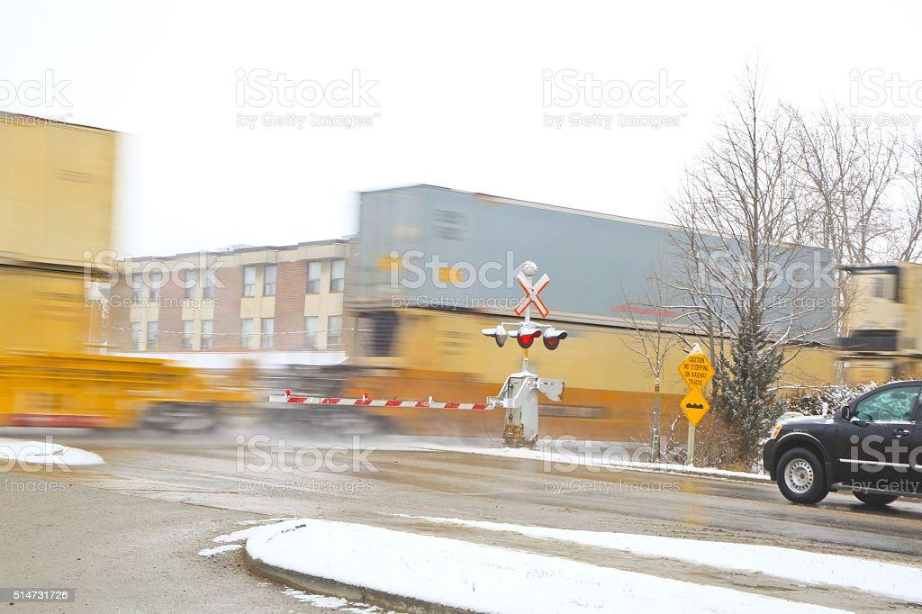 Freight Train Speeding Through a Town stock photo
