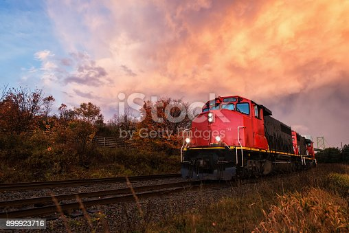 A diesel freight train in sunset light.