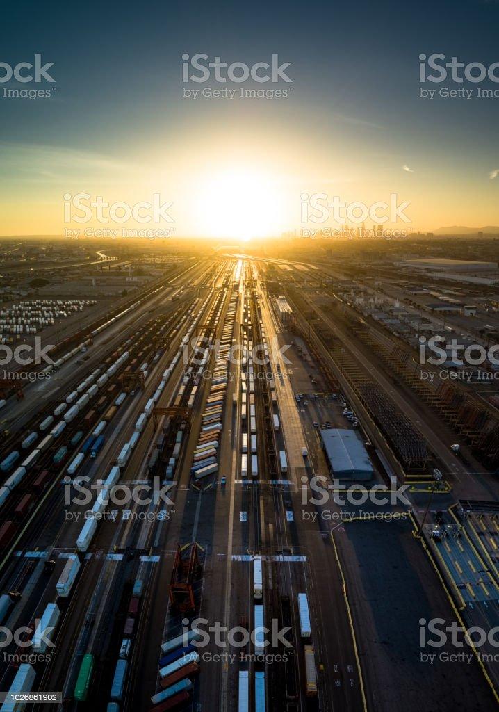 Freight Train Tracks Heading Into Sunset stock photo
