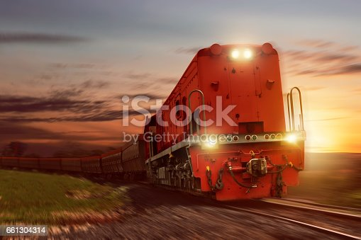 istock Freight train with cargo cars carrying coal 661304314