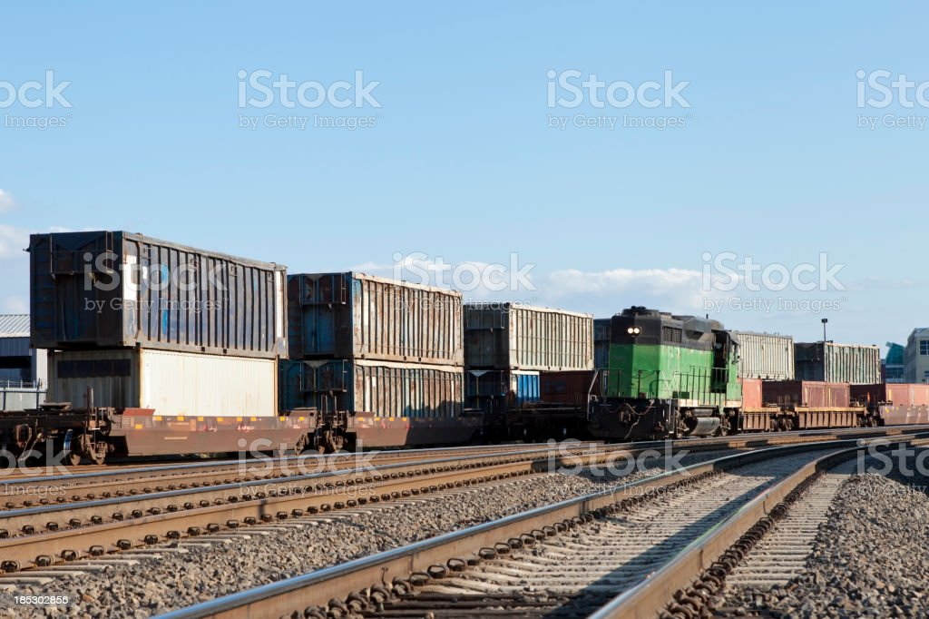 Freight train yard with railroad cars awaiting transport stock photo
