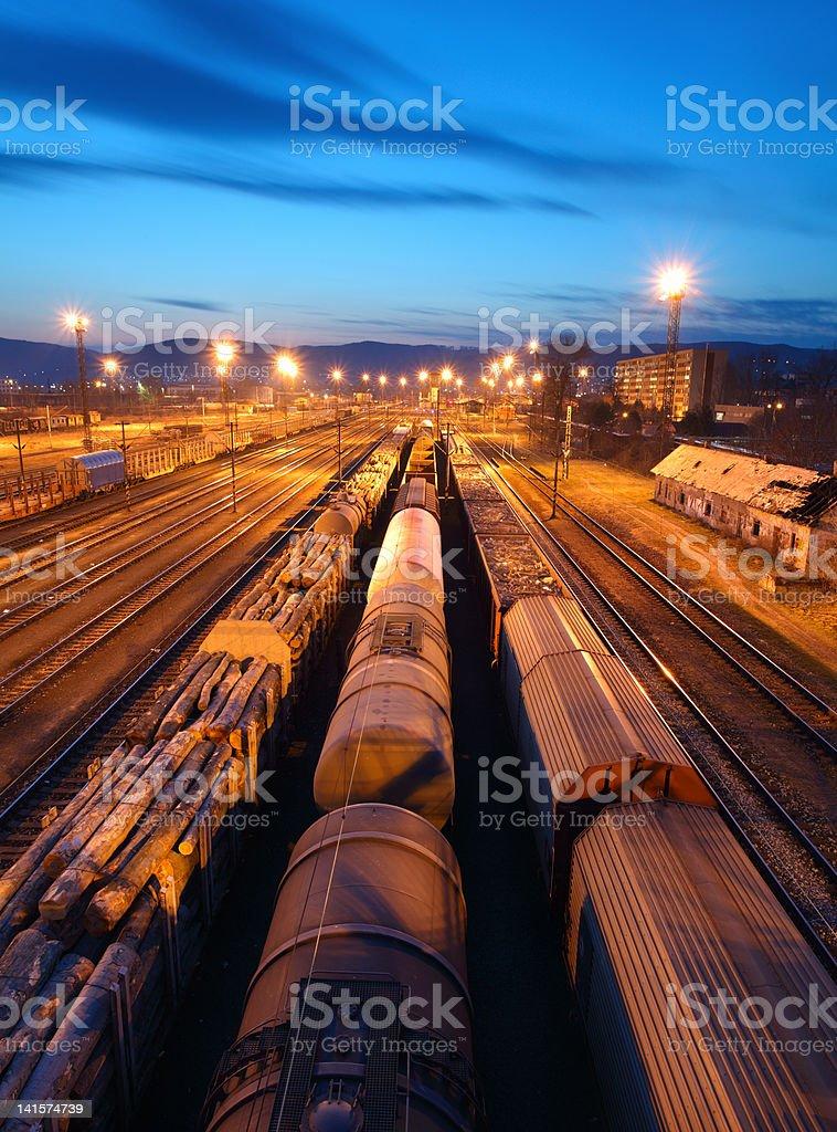 Freight Trains and Railways at dusk - Cargo transportation stock photo
