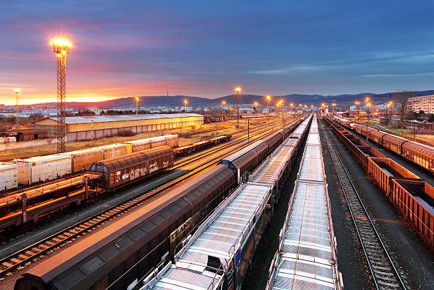 freight trains and railways at dusk - cargo transportation - godståg bildbanksfoton och bilder