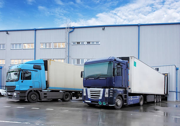 Freight Transportation - Truck in the warehouse Freight Transportation - Truck in the warehouse food warehouse stock pictures, royalty-free photos & images