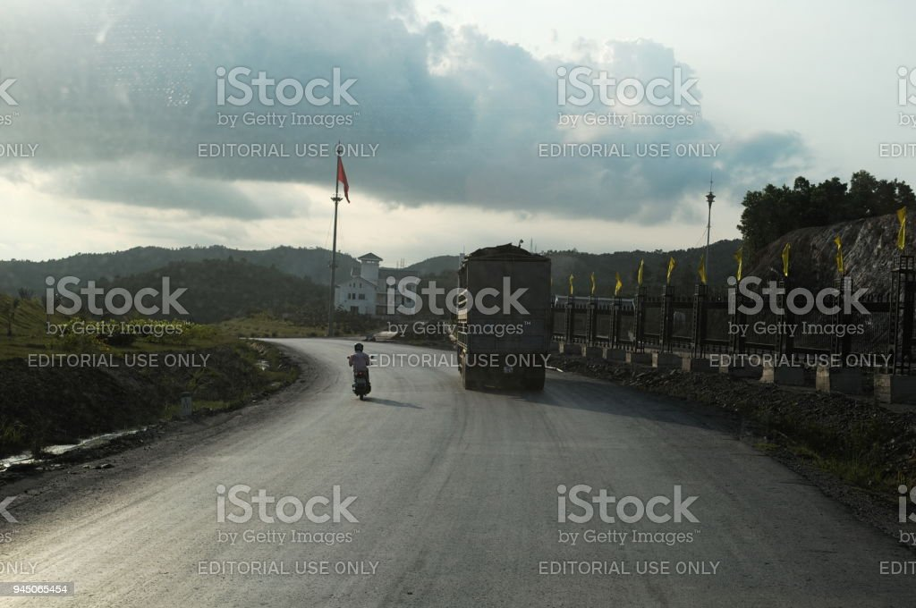 Freight truck with heavy carriage drive on a road stock photo