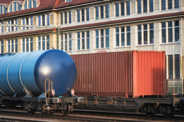 Freight wagons train on railway tracks. Close-up of freight trains Freight train wagons on railroad tracks, in Singen train station, Germany, in sunset light. Close-up of train wagons for merchandise distribution. singen stock pictures, royalty-free photos & images