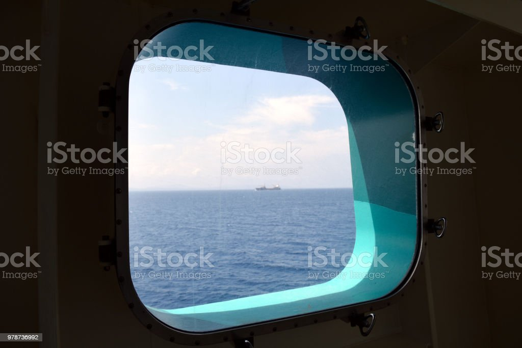 A Freighter Outside the Porthole stock photo