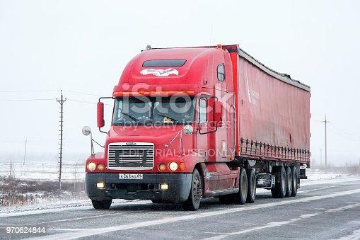 Novyy Urengoy, Russia - October 12, 2013: Semi-trailer truck Freightiner Century Class at the interurban road.