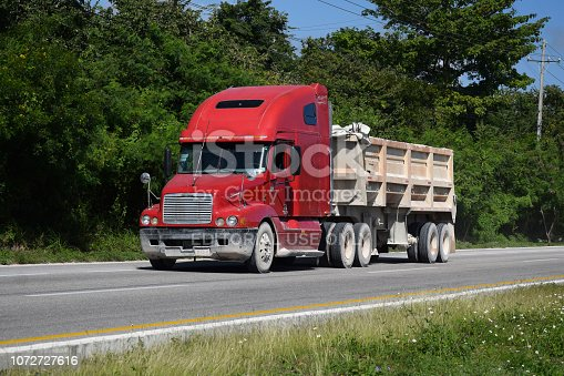 Cancun, Mexico - 11 January, 2018: Freightliner truck driving on the road. The Freightliner is a popular truck brand in America.