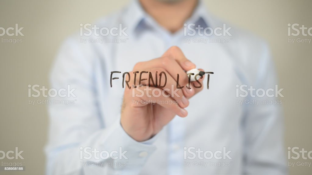 Freind List , man writing on transparent screen stock photo