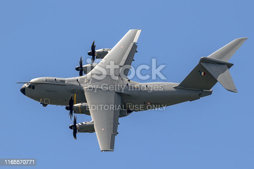 Paris - Jun 21, 2019: French Air Force Airbus A400M military transport plane banking in flight before touch down.