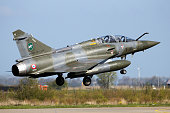 LEEUWARDEN, THE NETHERLANDS - APR 21, 2016: French Air Force Dassault Mirage 2000D jet fighter plane from Escadron de Chasse 2/3 landing on Leeuwarden airbase during military exercise Frisian Flag.