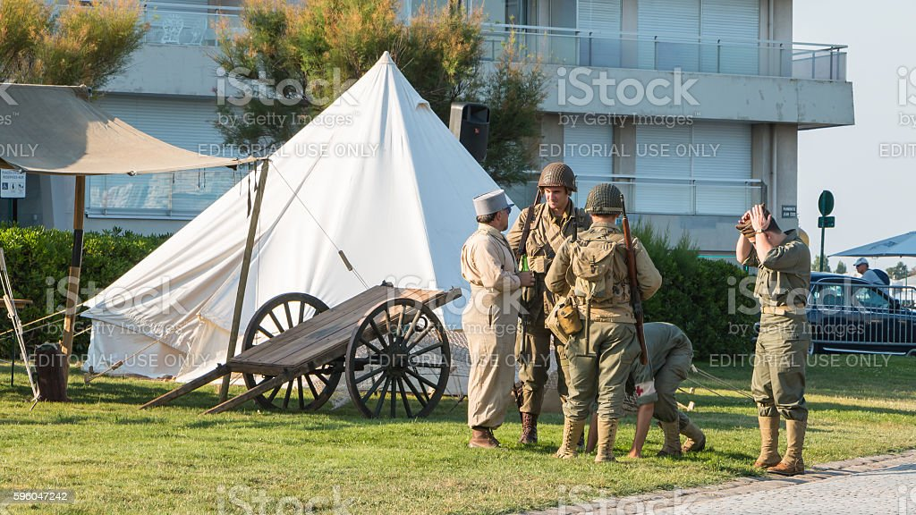 French and American soldiers relaxing in a reconstituted militar royalty-free stock photo