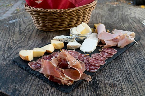 french appetizer with salami, cheese and ham - salami vorspeise stock-fotos und bilder